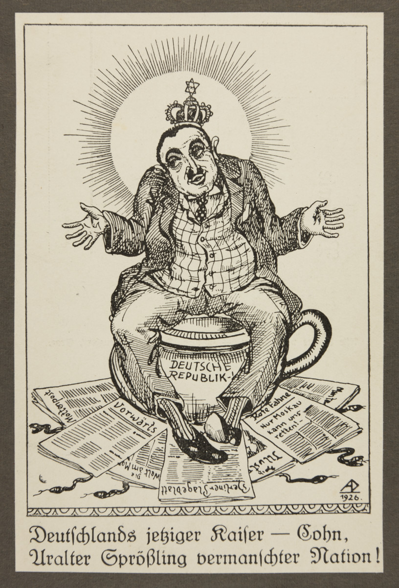 "Antisemitic propaganda of a stereotypical Jewish man posed atop the German Republic as a chamber pot under which various left-leaning German newspapers are strewn.  The text reads: ""Germany's present Kaiser--Cohn, the age-old scion of a mixed up people."""