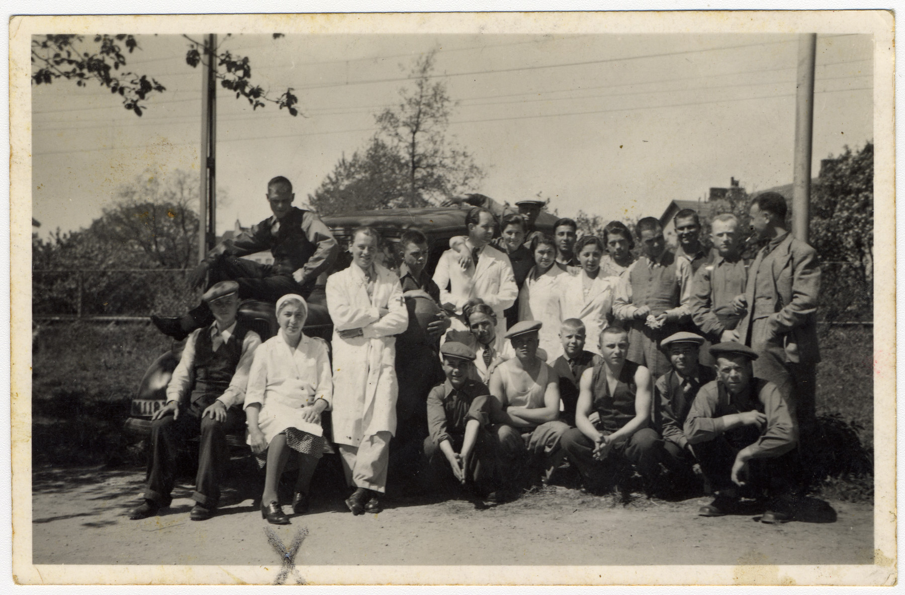 Group portrait of medical personnel and unidentified men in Sweden.   Among those pictured is Edith Scherzer, sitting second from the left in the first row.