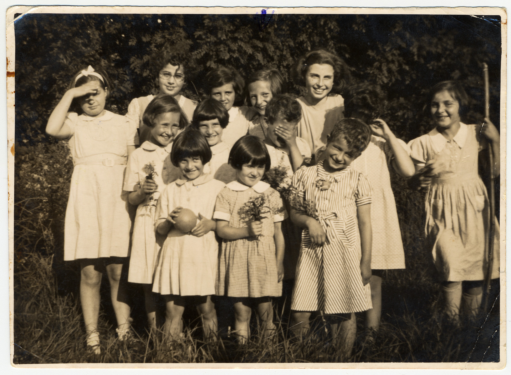 Group portrait of Jewish refugee girls who came to Great Britain on a Kindertransport.  Liesl Scherzer is pictured second from the right in the top row.
