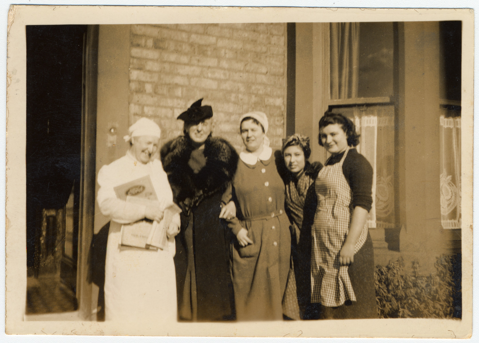 Women working in Windermere hostel pose together with a representative of the Newcastle Jewish Community who sponsored the Kindertransport.   Pictured from left to right are: Alice Urbach, Mrs. Wilkes from the Newcastle Jewish Community, Paula Sieber, Ilse Gross and unknown.