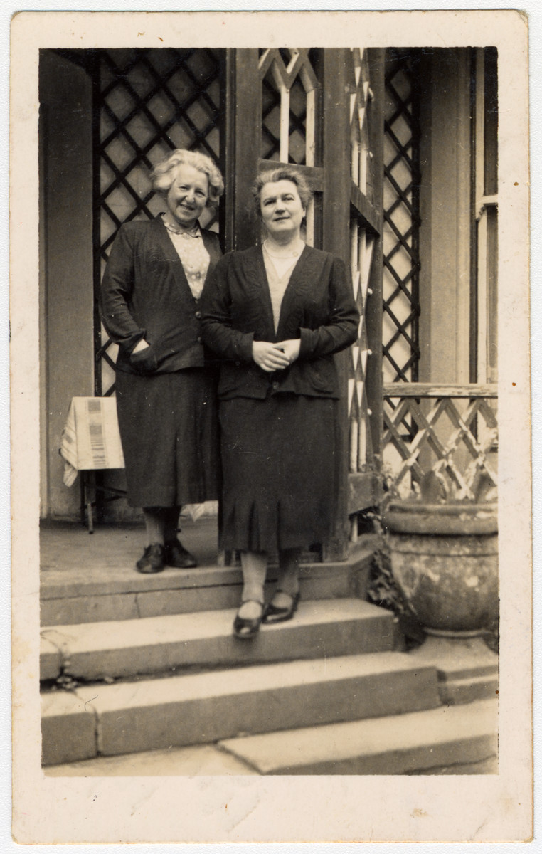 Alice Urbach and Paula Sieber, Jewish refugees from Austria working at the Windermere hostel, stand in front of the building.