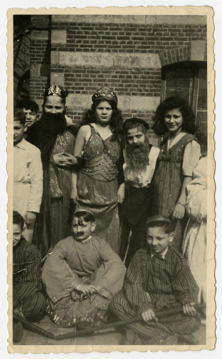 Jewish orphans from Home de la-Bas in Aische-en-Refail perform a Purim play as part of their relearning of their Jewish heritage.  Charles Rojer is seated on the far right with Maurice Sorgenstein, as Haman, seated to my right.