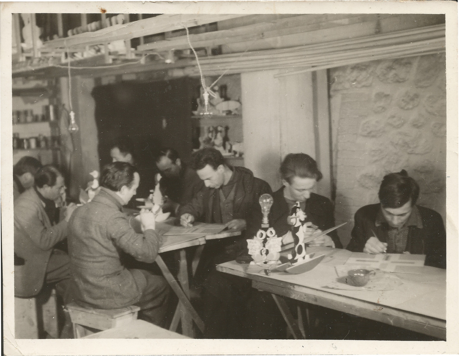 Internees decorate toys in a workshop in Les Milles.  Siegfried Lindheimer is pictured in the first row, second from the left.