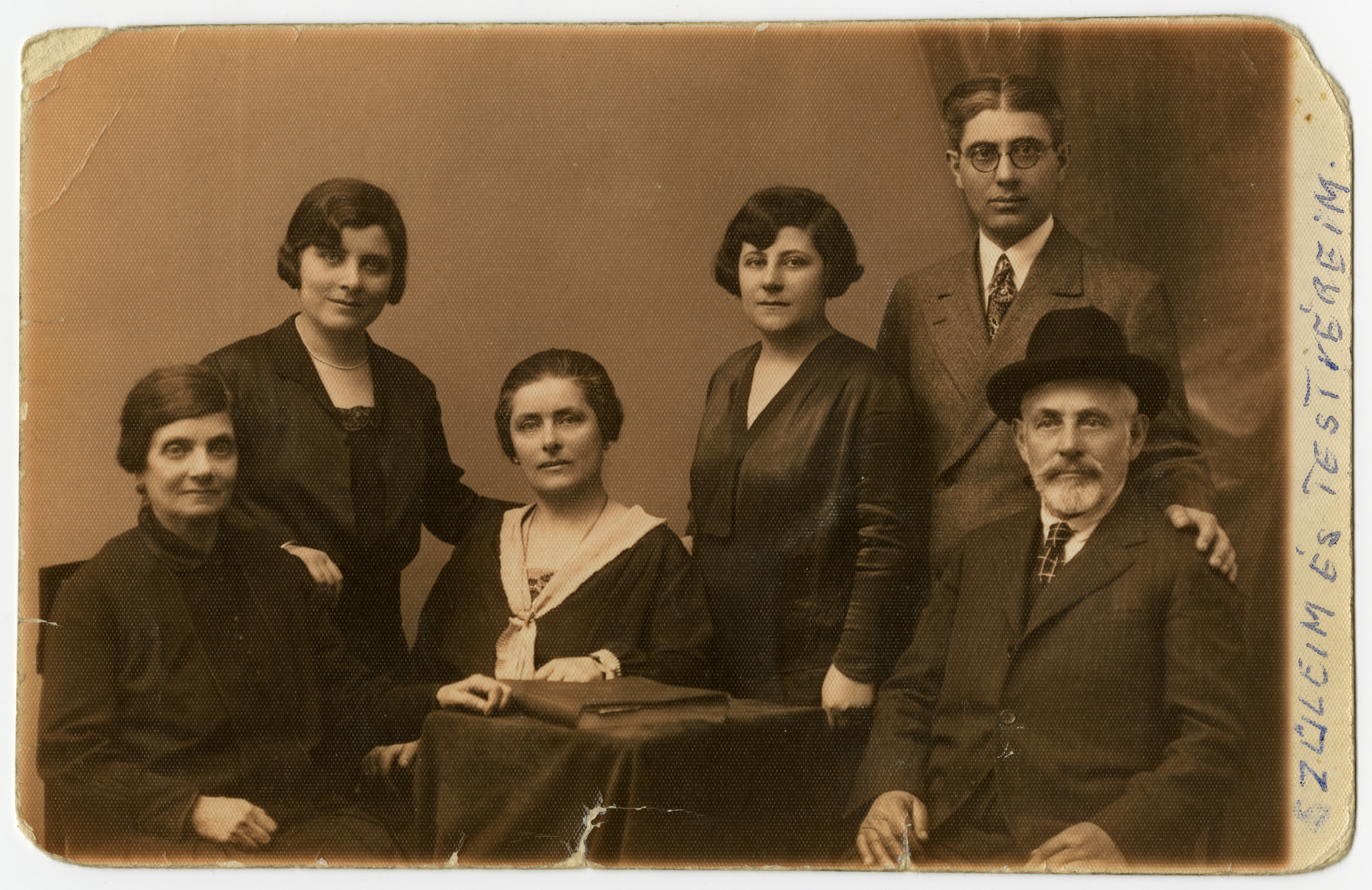 Studio portrait of the Kronovitz family.  Margit Kronovitz (the grandmaother of the donor) is third from the right. Her brother Lutzi who is next to her.  He immigrated to the United States. in  1929. Her parents and sisters perished in the Holocaust