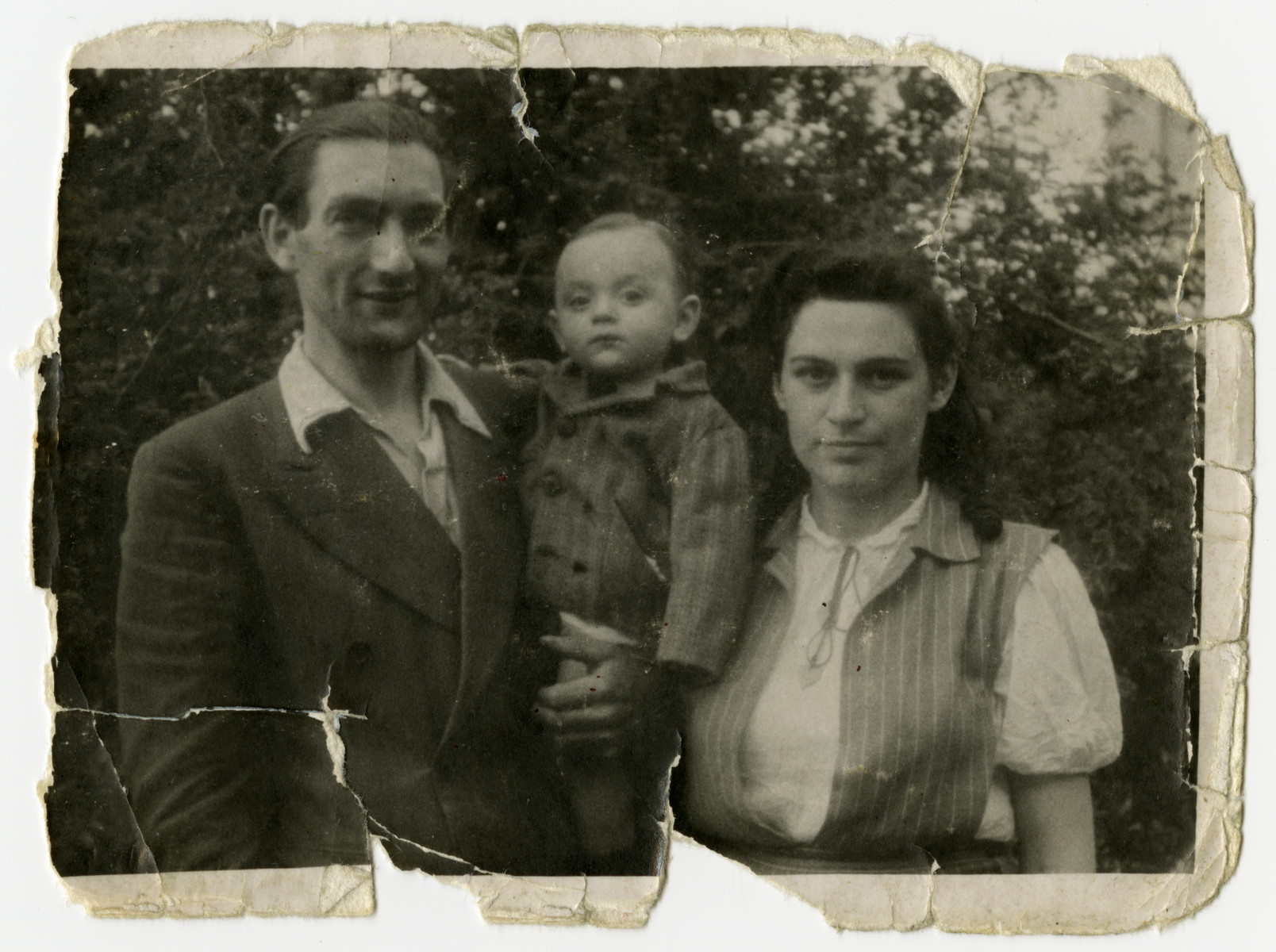 Close-up portrait of the Raysman family after returning from the Soviet Union.  From left to right are Motel, Marusia and Hershel Raysman.
