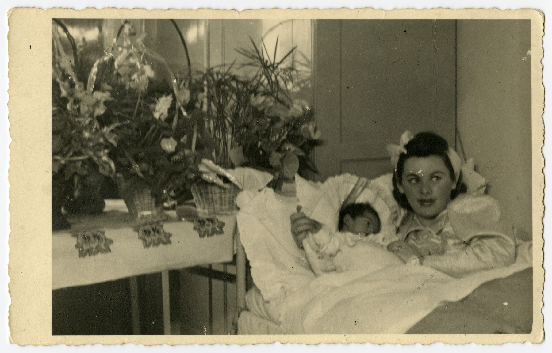 Mother with a newborn baby.  Her husband and child died in Auschwitz.  She survived and became a Catholic after the war.