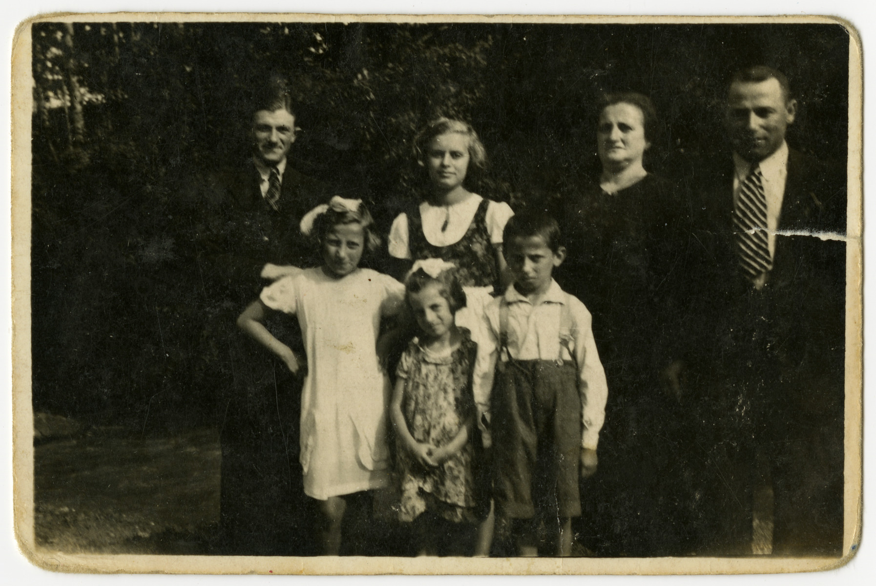 Group portrait of an extended Polish Jewish family in prewar Bolechow.  Regina Zarwanitzer is standing in the back row, second from the left.