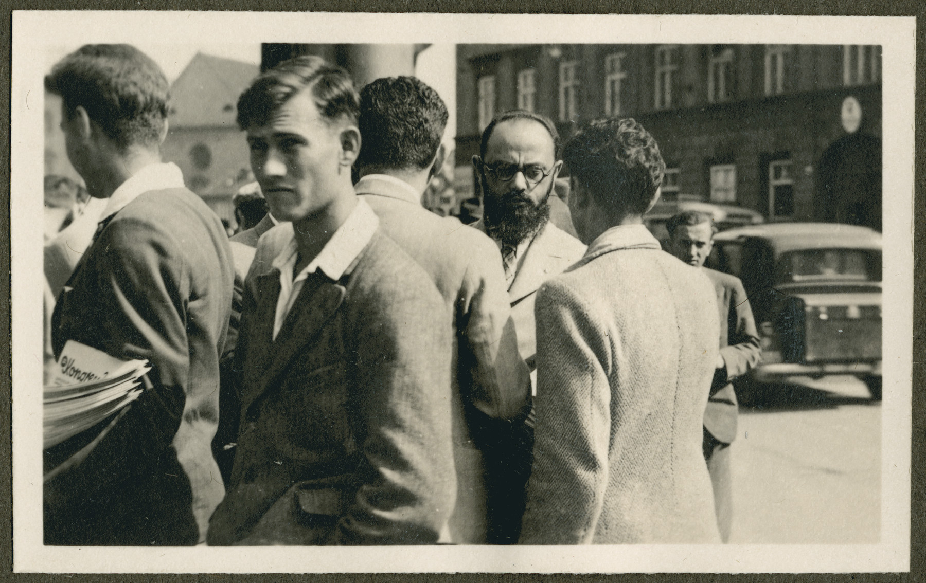A group of men stand outside probably during the 18th Zionist Congress.