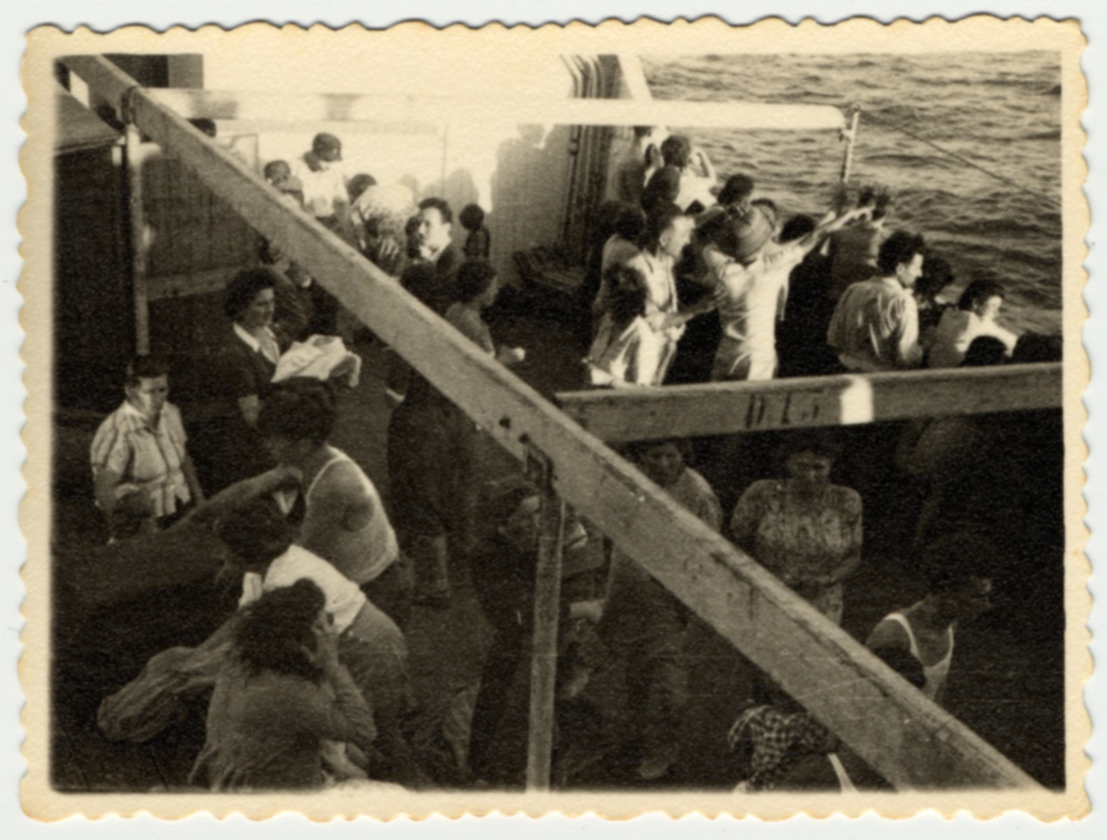 Passengers gather on the deck of [what is probably the Atzmaut, Pan Crescent].