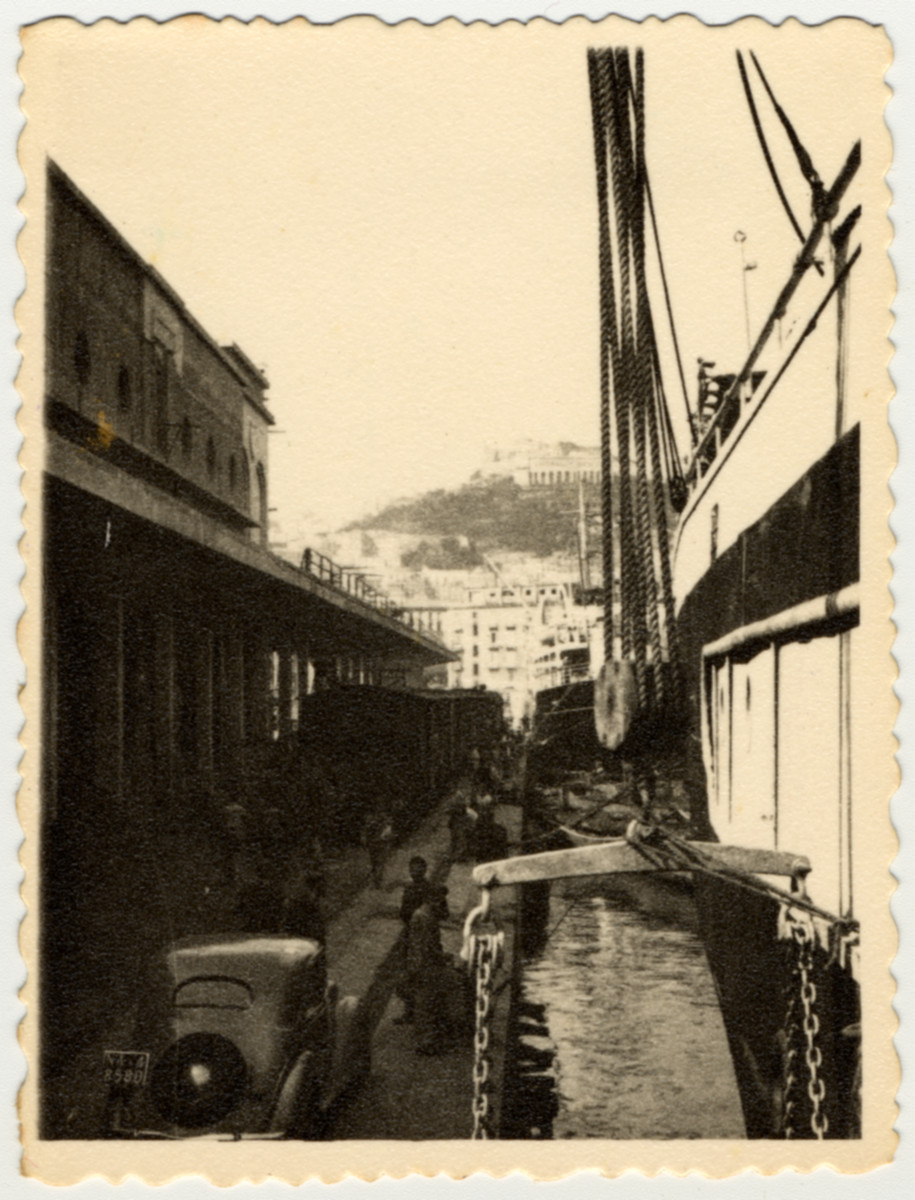 Passengers arrive by train to the port of Naples where they will board the S.S. Caserta.
