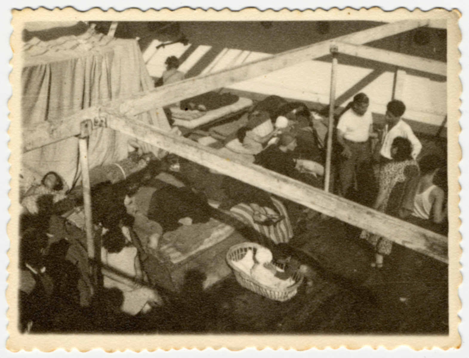 Jewish immigrants evacuating Cyprus for Israel rest on a deck of [what is probably The Atzmaut, Pan Crescent].
