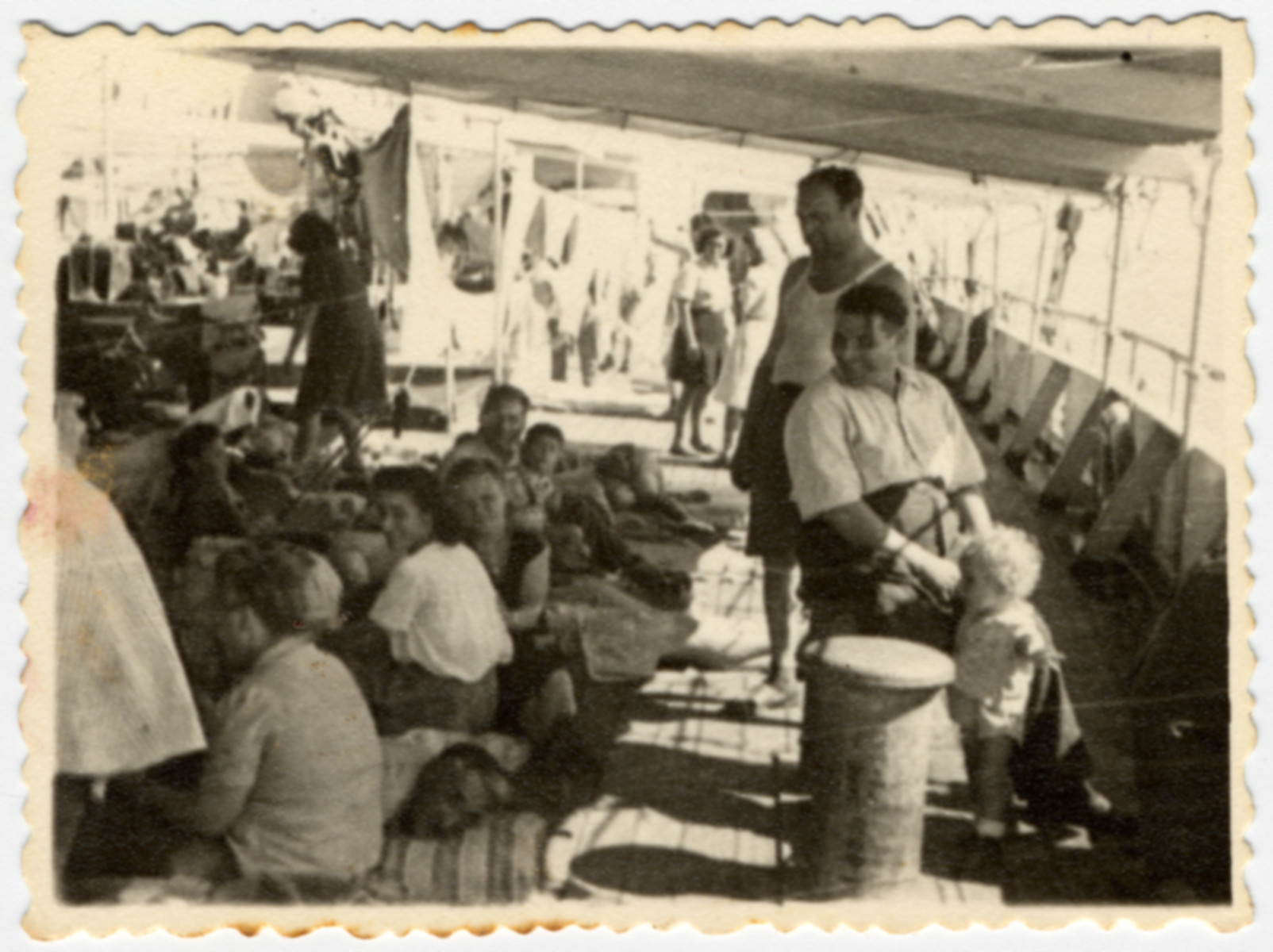 Passengers relax on a deck of  the Atzmaut (Pan Crescent) while en route to Palestine.