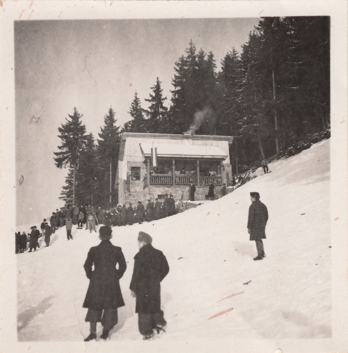 Members of a Jewish forced labor battalion gather on a snowy hill outside of Hajduhadhaz.