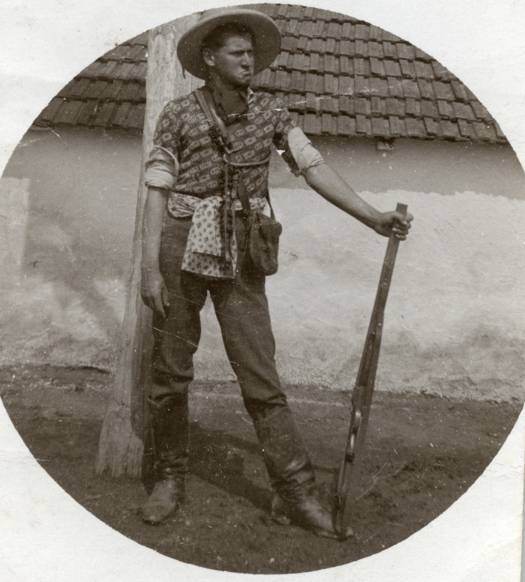 Lajos Weisz stands with a rifle dressed like a cowboy.