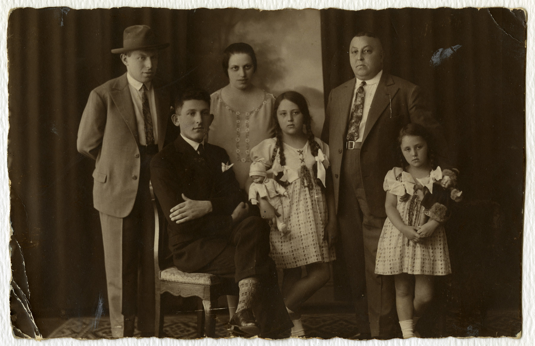 Prewar portrait of the Gold family.  From left to right are Hymie Schiffman, a cousin from Romania, Fanny Gold, Erna Schiffman, Peter Gold and Ruth Gold.