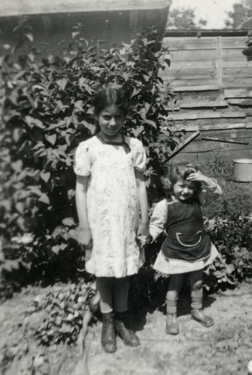 Agi (Agnes) Klein (right), the young daughter of Lili Suryani, poses with an older child.  Agi was killed in Auschwitz three years later