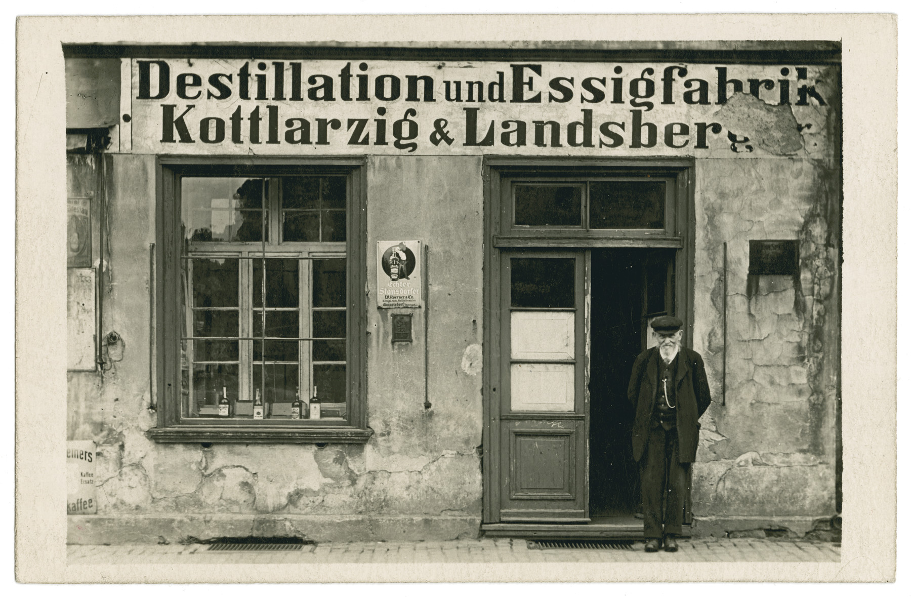 Samuel Kottlarzig (a great uncle of the donor) stands in front of his distillery for wine and vinegar in Ohlau, Schlesien, Germany.   He and his three children Else, Sofie and Alfred also owned a pub in Ohlau .The three of them were killed by the Nazis in concentration camp - probably Auschwitz.  Their sister Regina survived Terezin.