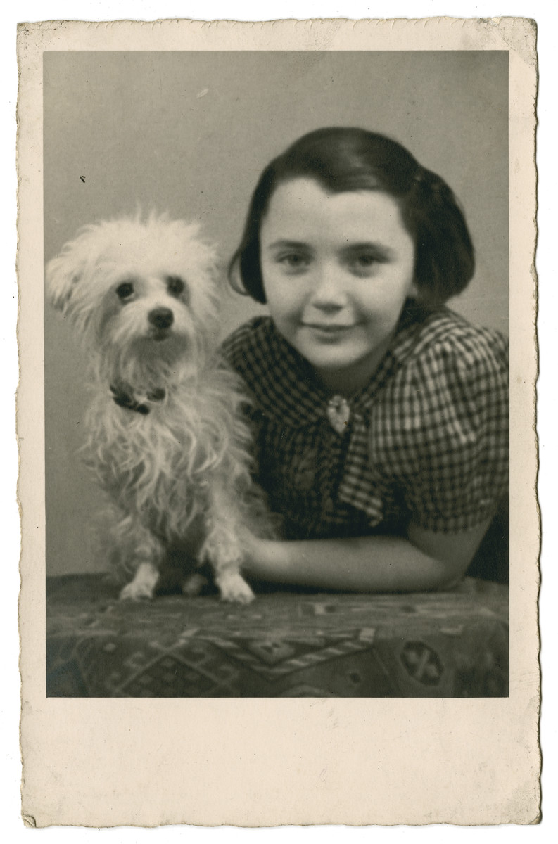 Sonja Goldman (a friend of the donor) poses with her dog prior to her immigration to England..  She met Ilse at the Refugee Hostel 34 Wheeleys Rd., Birmingham and became best friends. Sonja's mother worked as a domestic in Birmingham while Sonja lived in the Refugee Hostel. Sonja later married an Englishman, Hank Hancox.