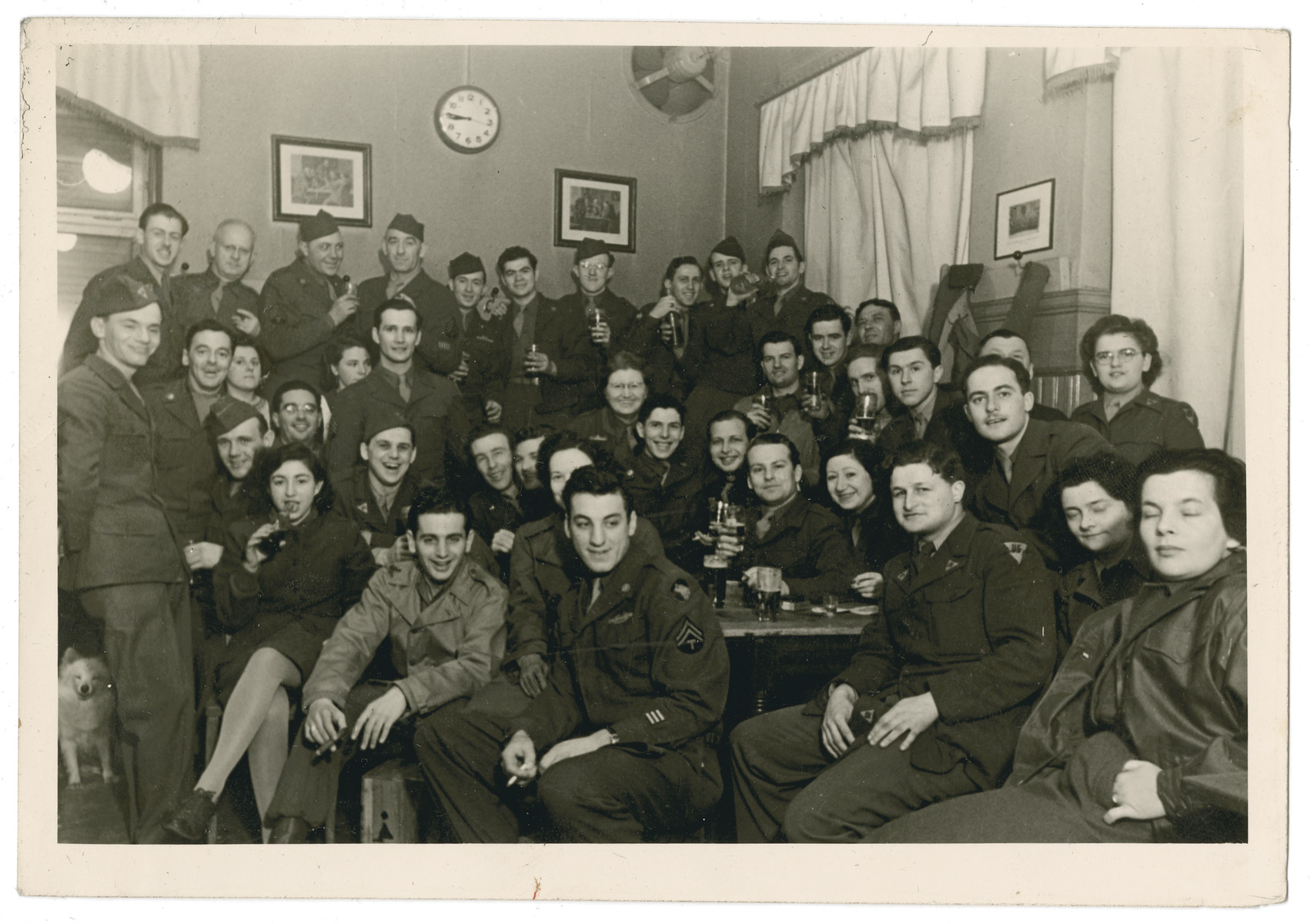 Group portrait in Otto's Pub in Offenbach of  some of the staff of the American War Department's Civil Censorship Division.