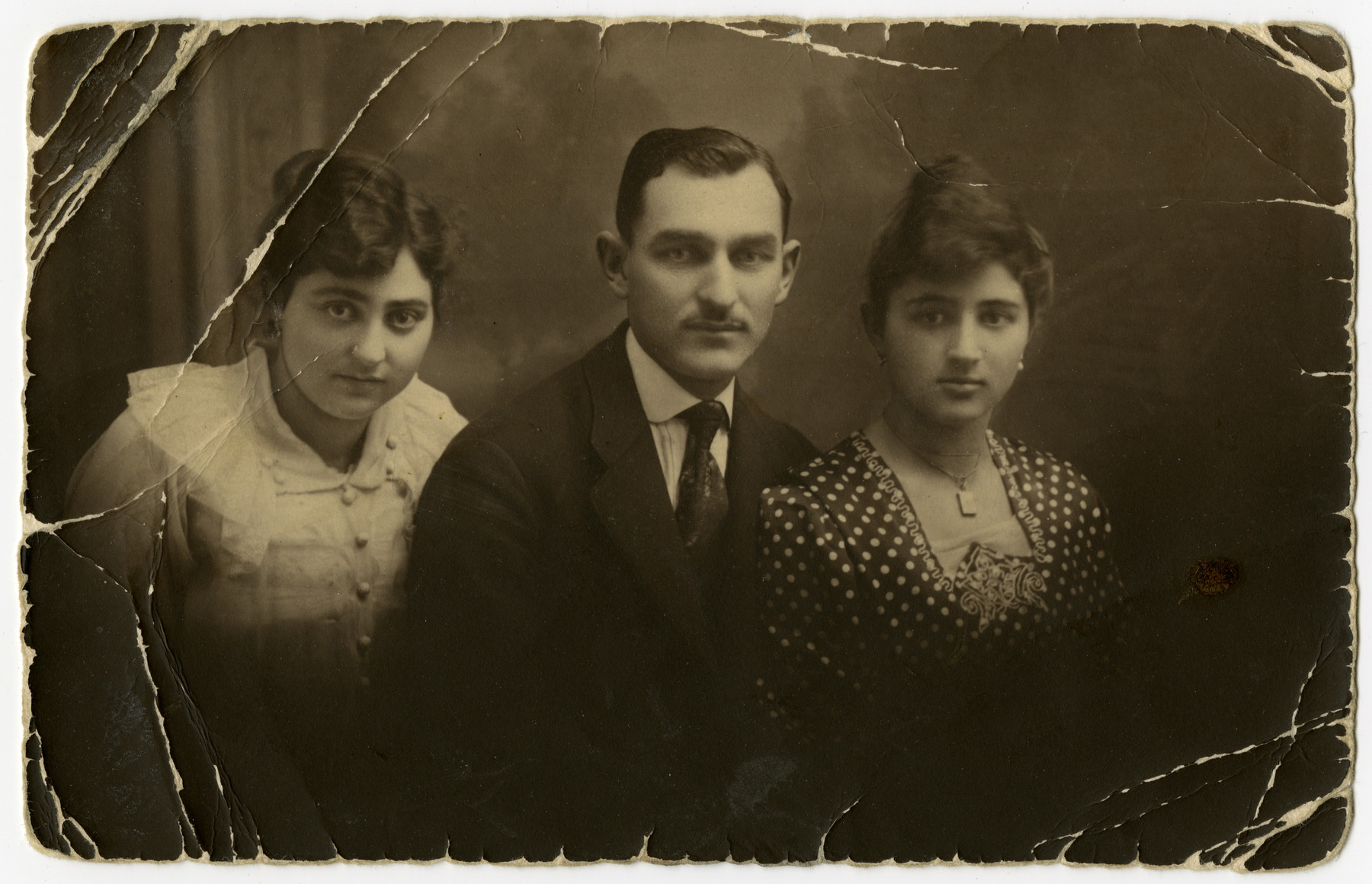 Three family members pose for a portrait.   From left to right: Mariska-Miriam Herskovits, Emanuel Herskovits, and Regina (last name unknown).