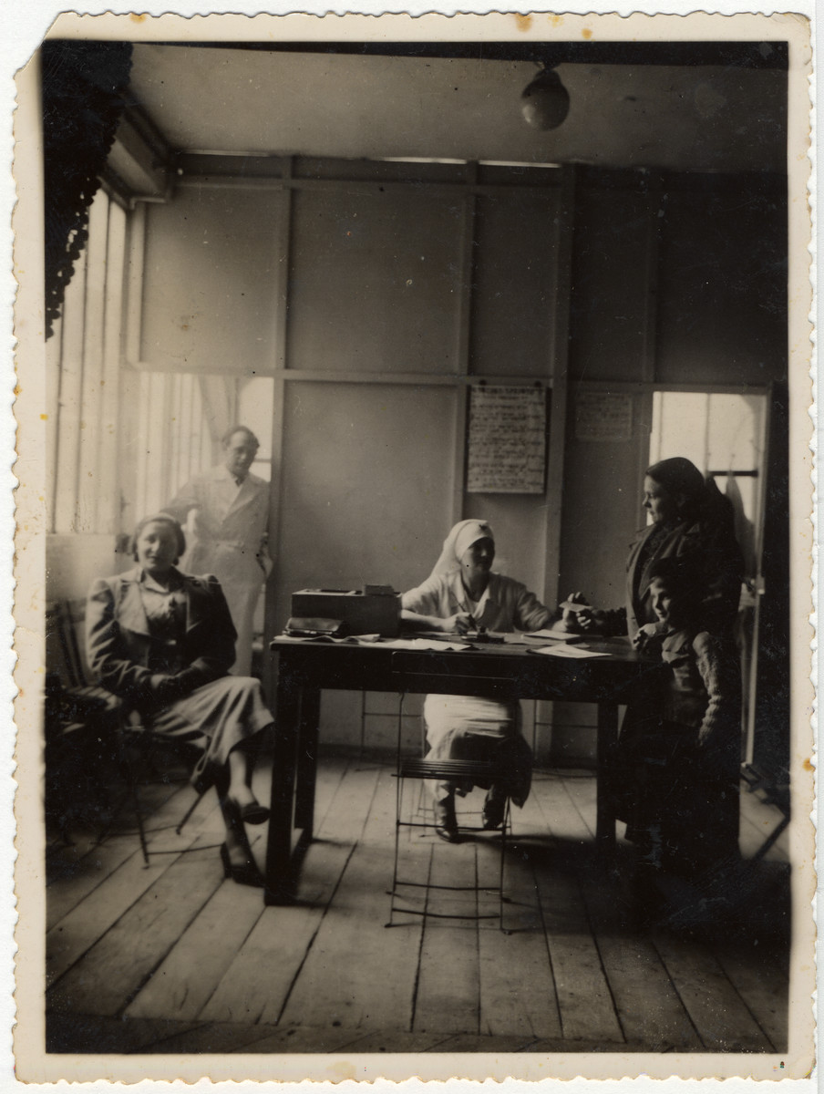 Dr. Bor (standing left) works in the Jewish clinic in Paris.  Dr. Bor was Roche Leja Gimmelstein's friend in Lithuania.