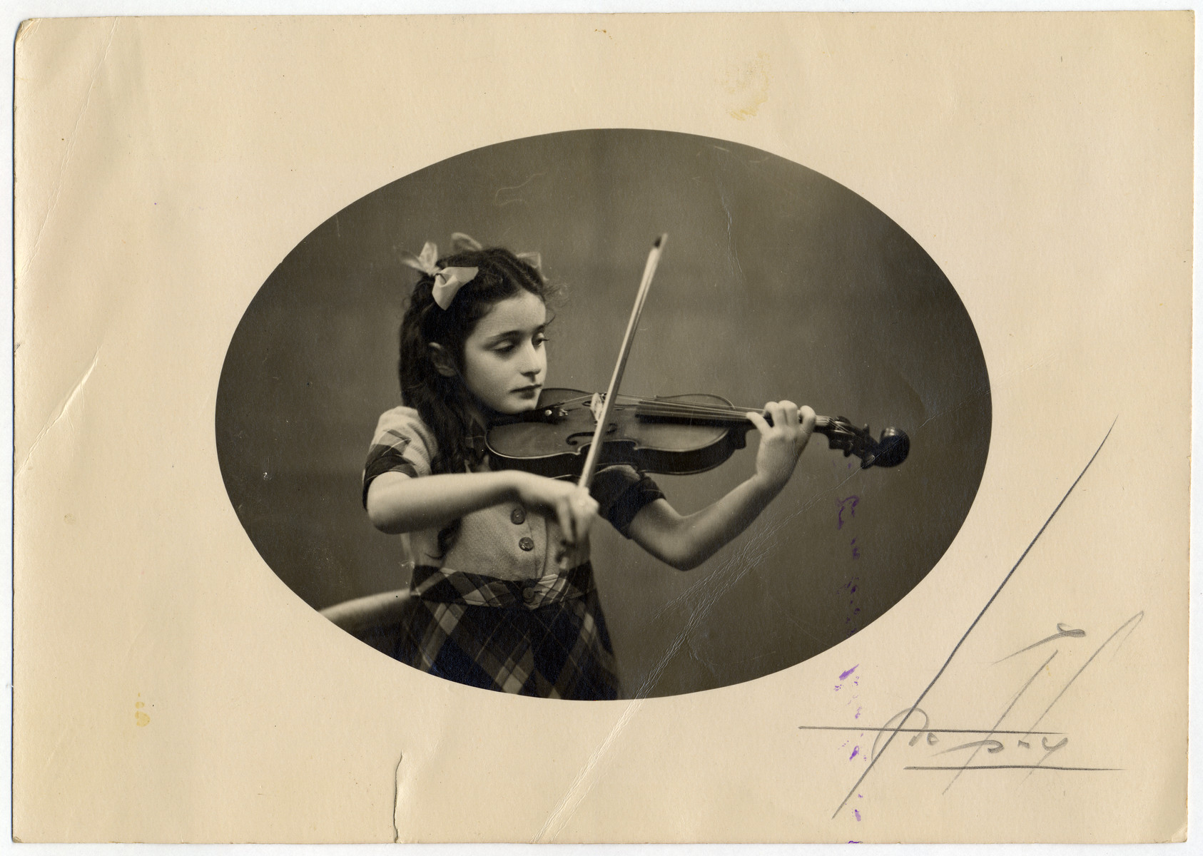 Studio portrait of Annette Gimelstein Tazartes (cousin of the donors) playing the violin.