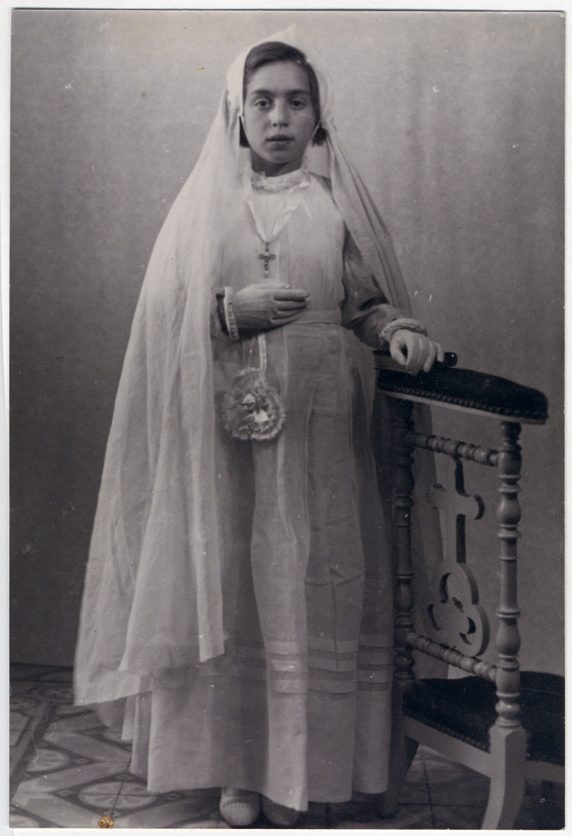 Paulette Feiler, a  French Jewish girl takes her first communion while in hiding.