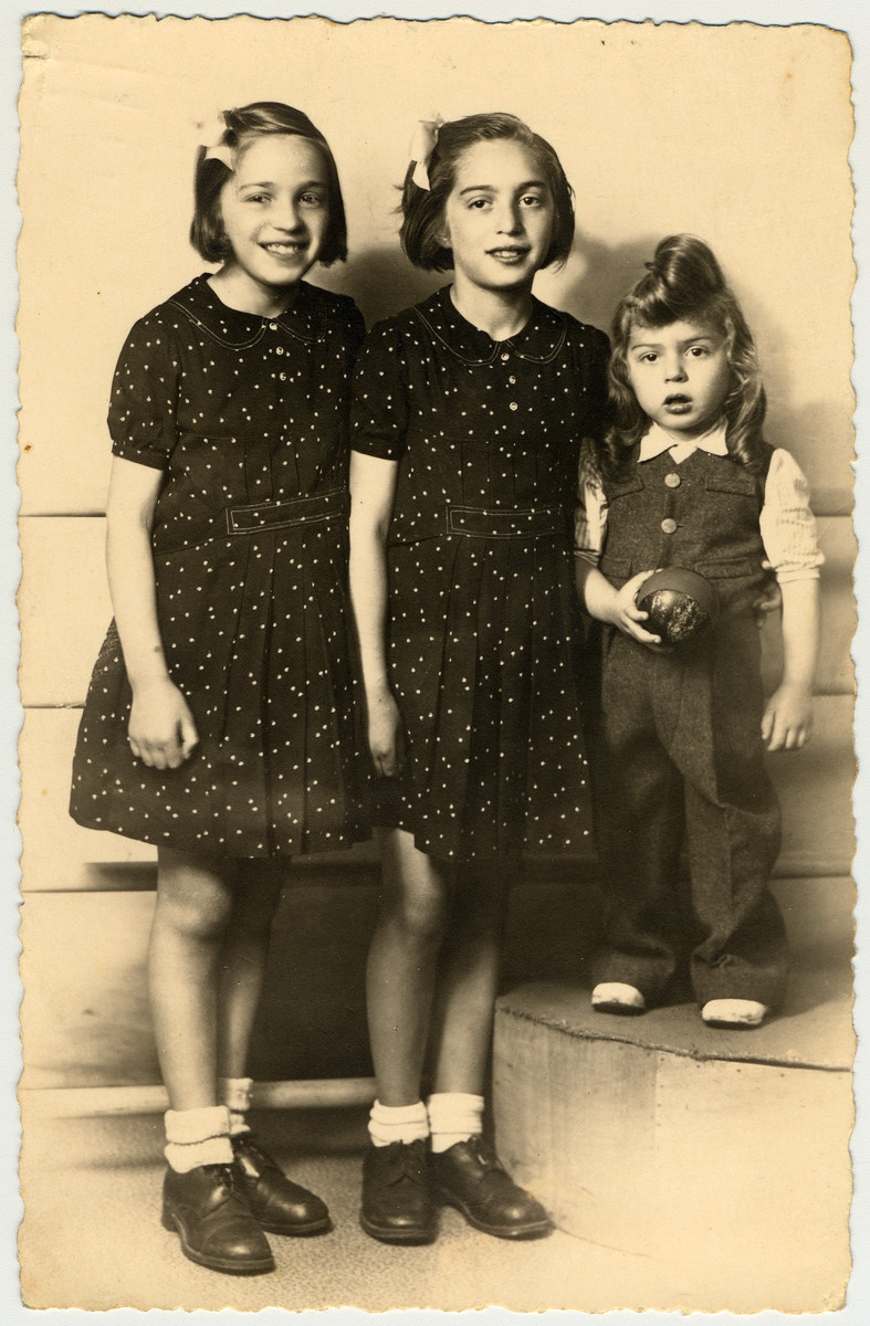 Studio portrait of three French-Jewish siblings taken before they went into hiding.  Pictured are Paulette, Dora and Michel Feiler.