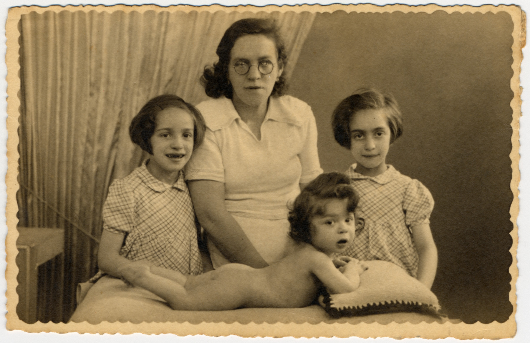 A Jewish mother, Roche Leja Feiler, poses with her three young children in Paris, France.  Pictured are Dora Feiler (left), Roche Leja Gimelstein Feiler, Michel Feiler and Paulette Feiler.