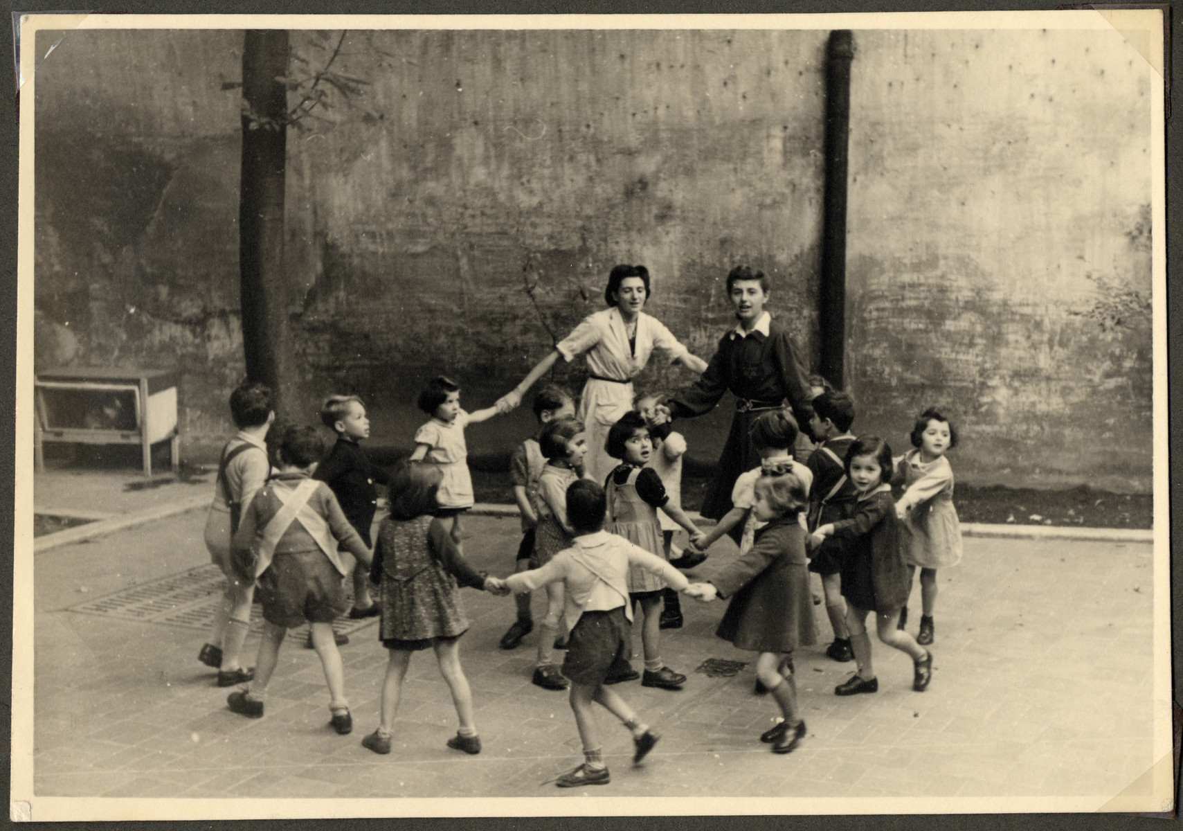 Children in the Nos Petits Jewish kindergarten dance in a circle.
