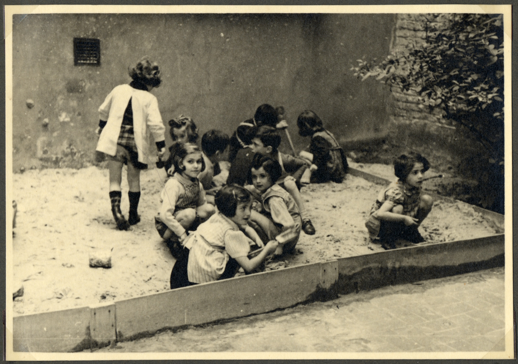 Children in the Nos Petits Jewish kindergarten play in the sandbox.
