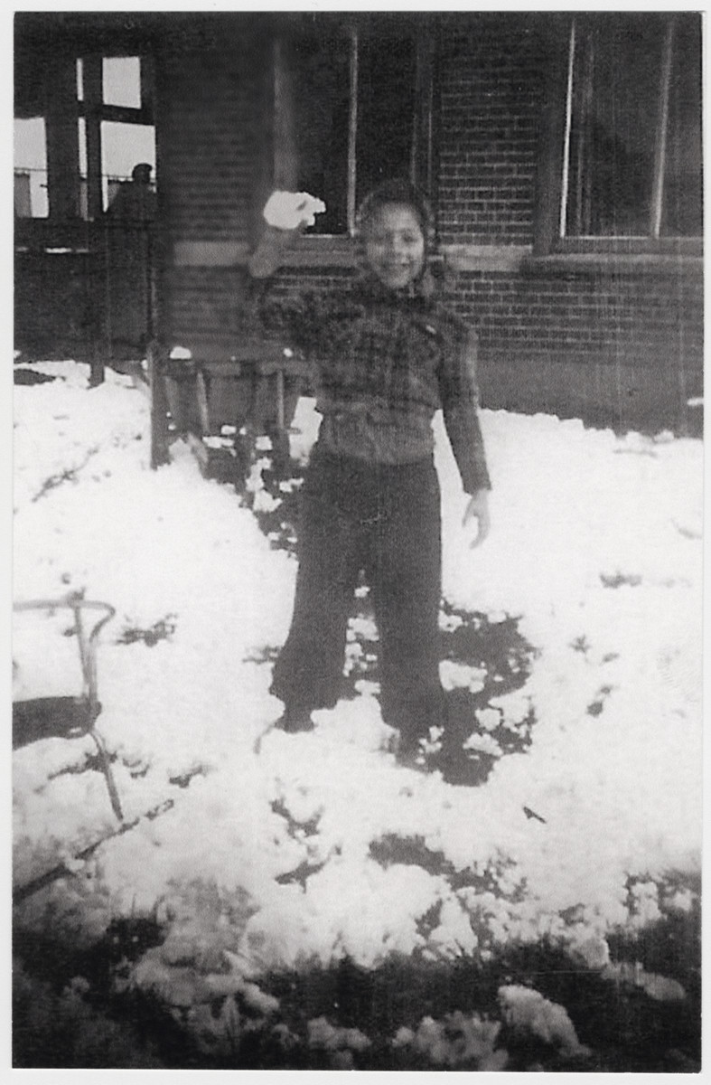 Edebeth Lopez Cardozo, a Jewish girl in hiding, prepares to throw a snowball.