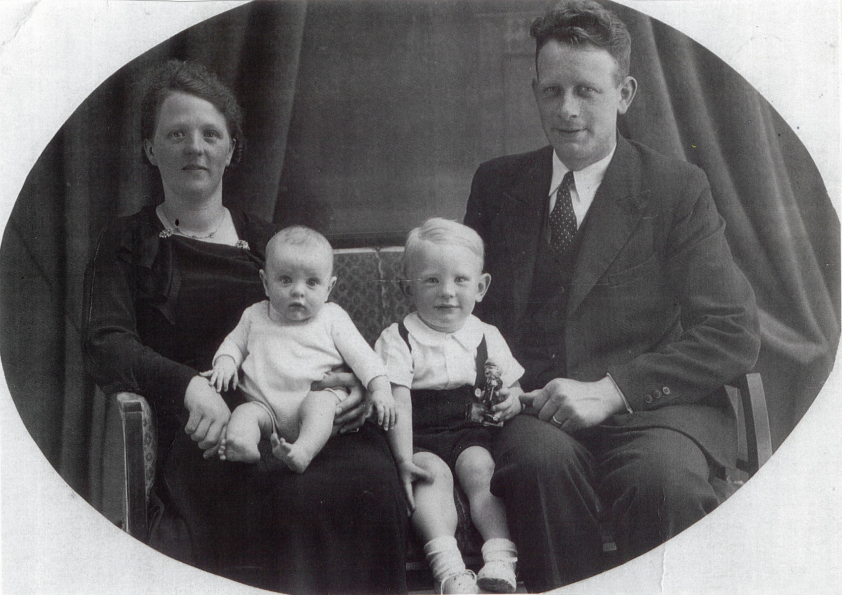 Portrait of two Dutch rescuers with their children.  Pictured are Johannes and Catherine Berkhout with their children Jack and Gerry.
