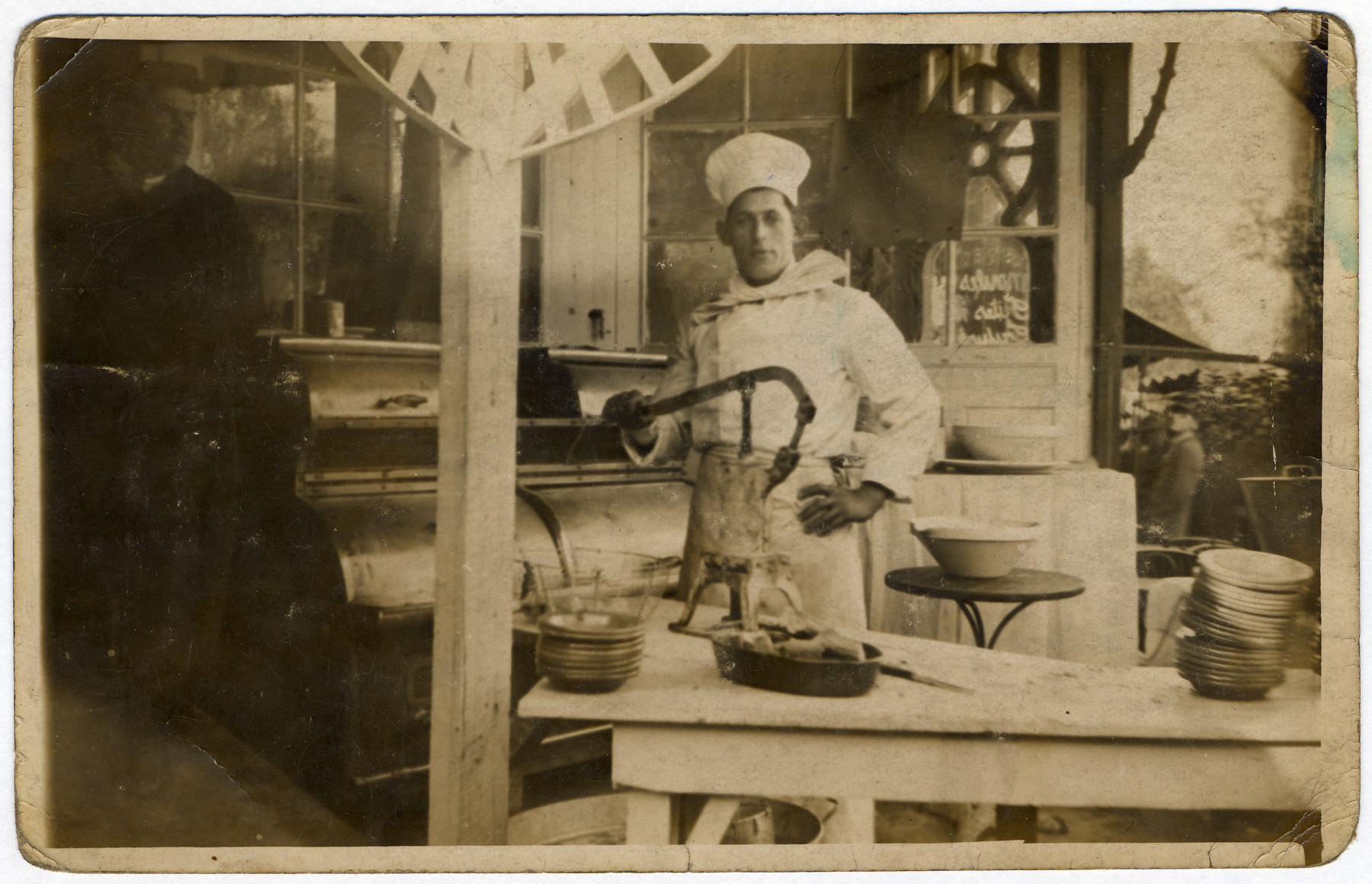 Chef Jacques Gimelstein works in the kitchen of the cafe of his brother, Albert Abramowitch.