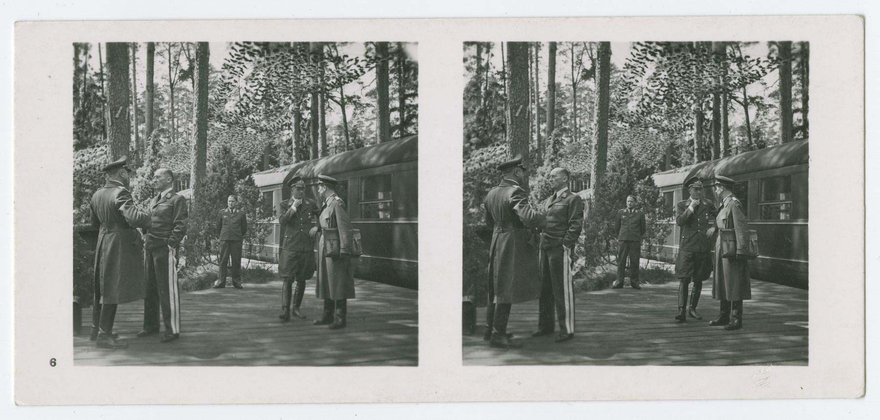 A stereograph of General Kastner arriving at an aviation headquarters.  Original caption in German reads:  General d. Fl. Kastner empfängt in Flieger-Hauptquartier Kuriere der einzelnen Luftflotten