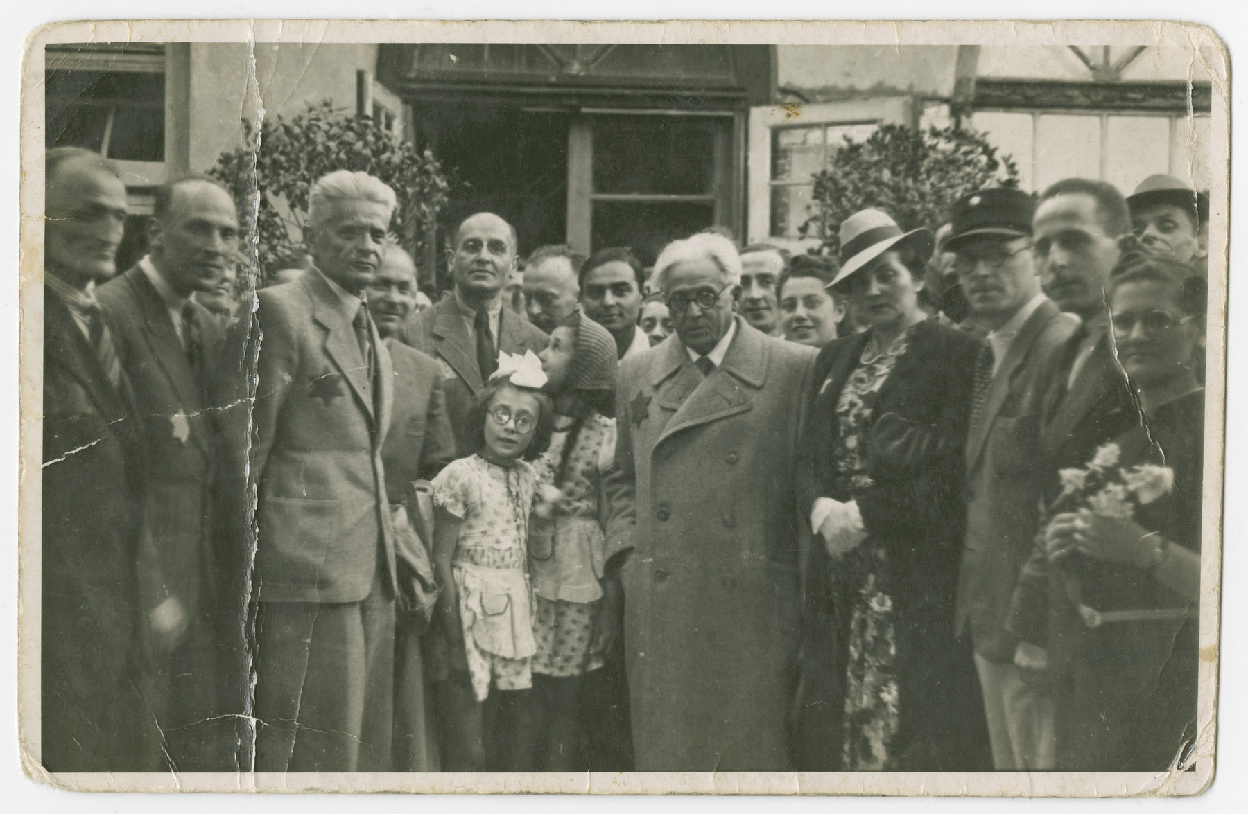 Mordechai Chaim Rumkowski poses with Jewish residents of the Lodz ghetto.