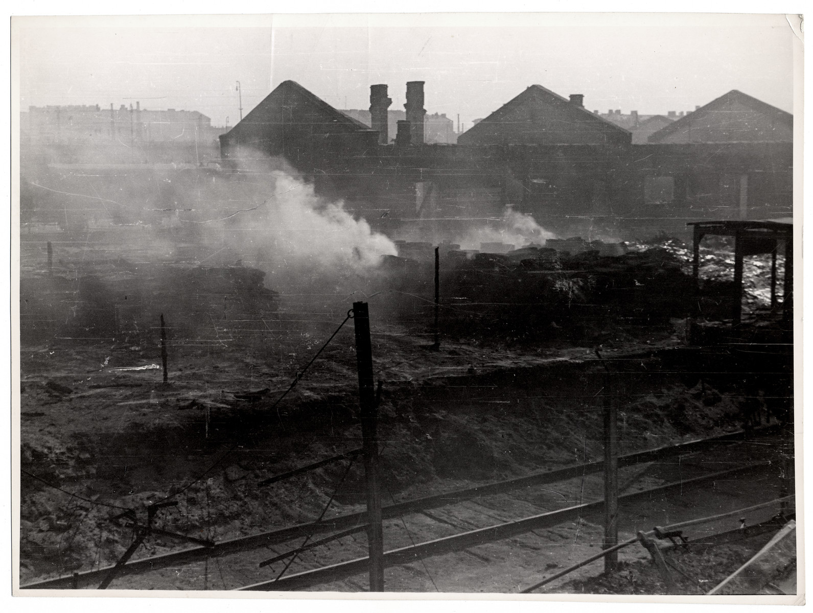 """""""Food warehouses set afire by incendiary bombs"""" in besieged Warsaw.   Caption from Bryan's book """"Siege."""""""