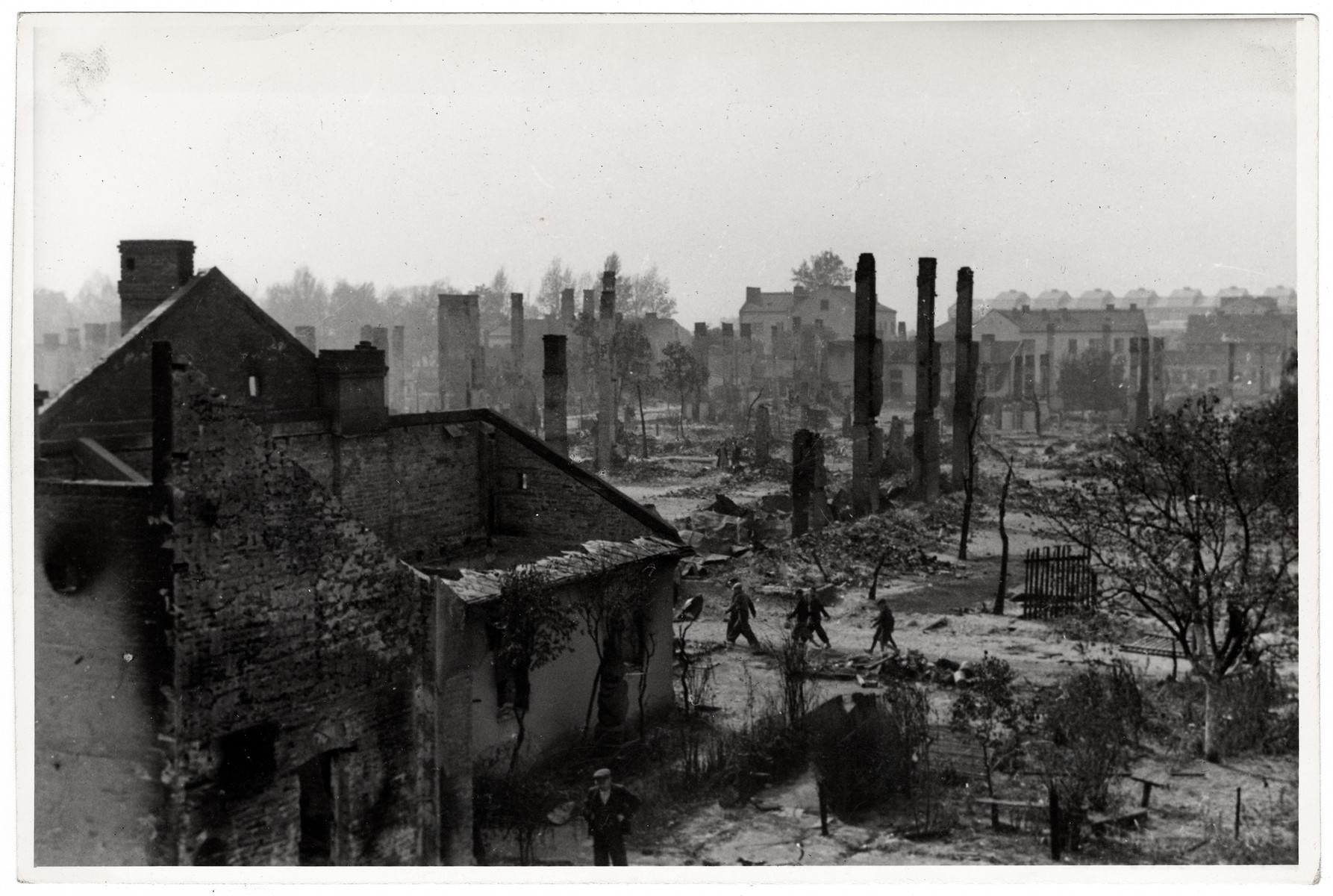 Poles walk among the ruins of besieged Warsaw.
