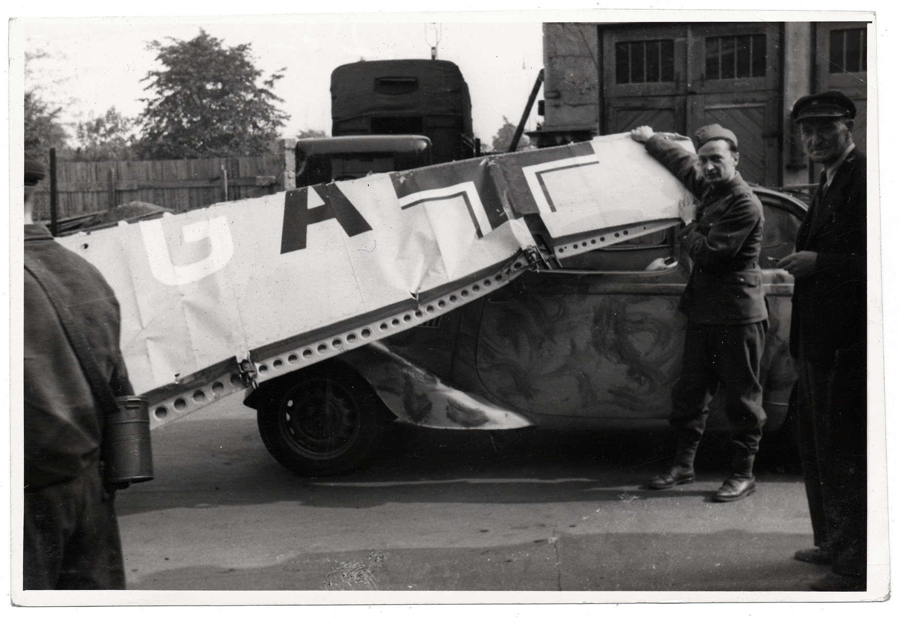 A Polish soldier poses with a tank in besieged Warsaw.