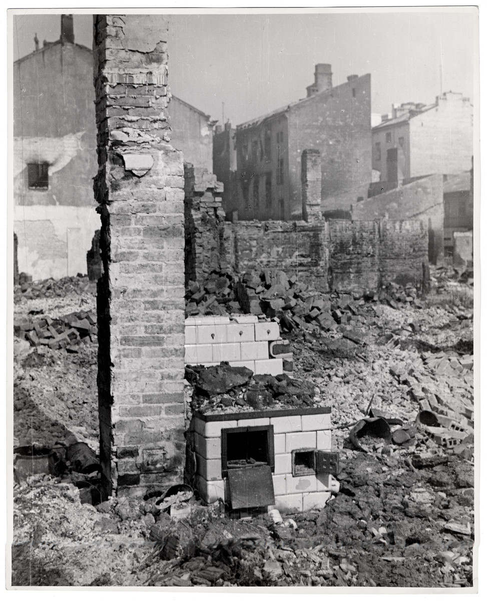 A bombed out home in the besieged capital of Poland - only the chimney and stove remain relatively intact.