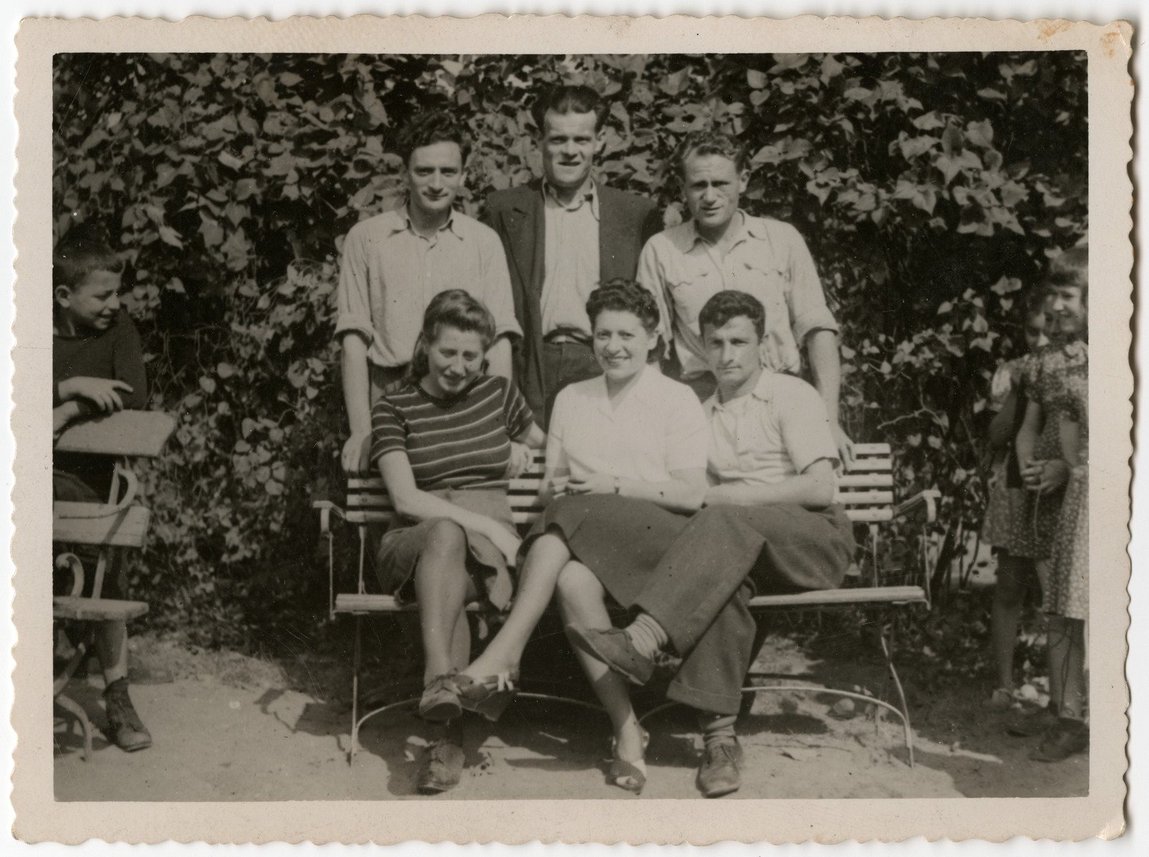 Group portrait of six displaced persons in the Schlachtensee camp.  Pictured are Mosie, Juita, Podesswa, Lew, Dora, and Orlkinowa.