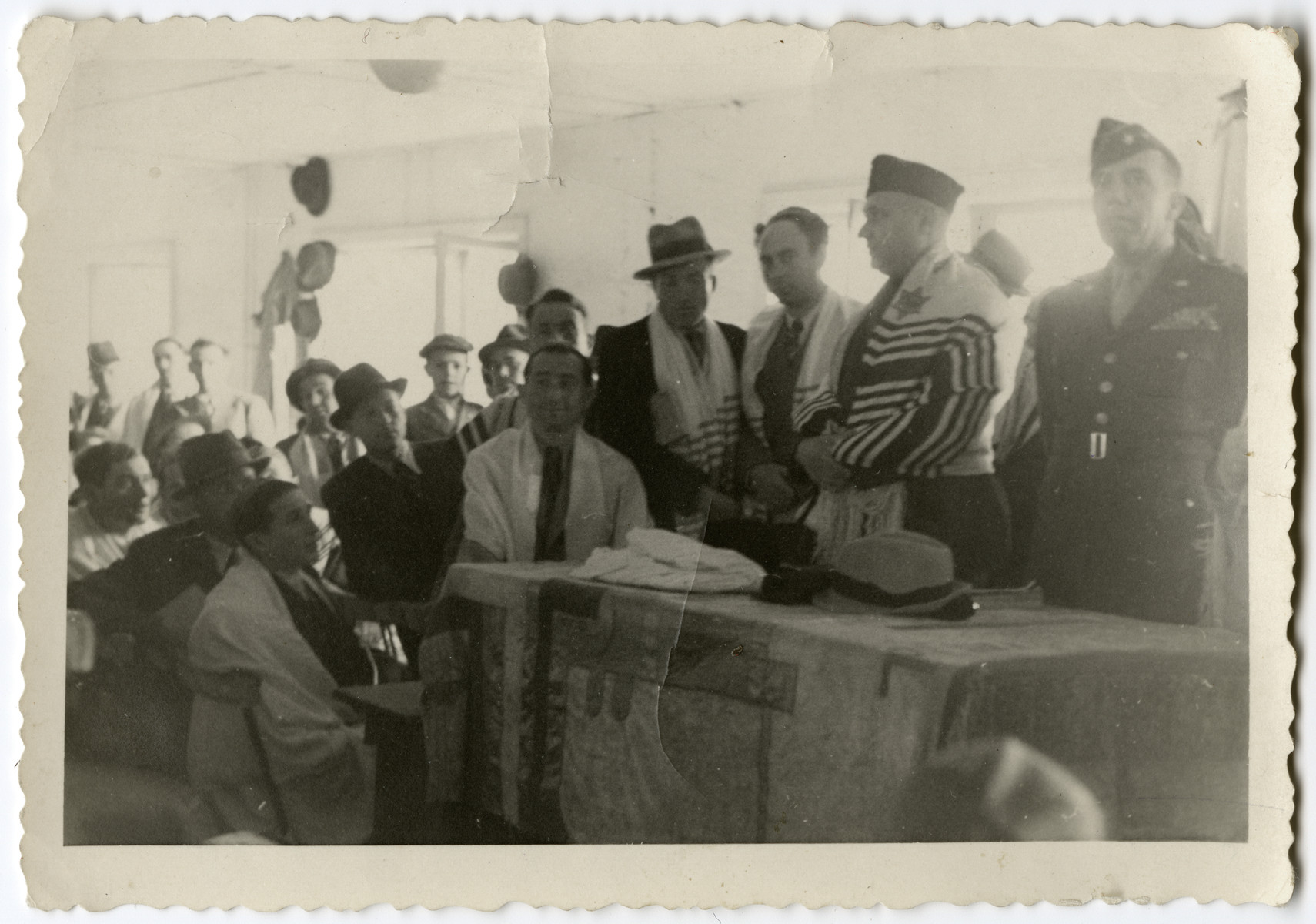 Rabbi Harold Fishbein conducts a religious service in the Schlachtensee synagogue.  He has a Jewish star sewn onto his tallit.