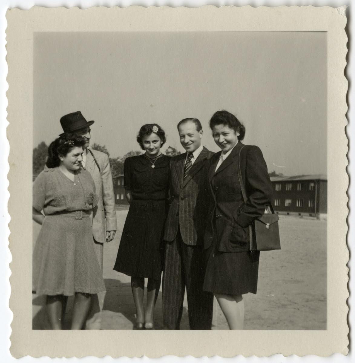 Group portrait of residents of the Schlachtensee displaced persons' camp.  Pictured are Szmuszkowiczowie, Fela Proszowska and Alfred and Laura Kimmel.
