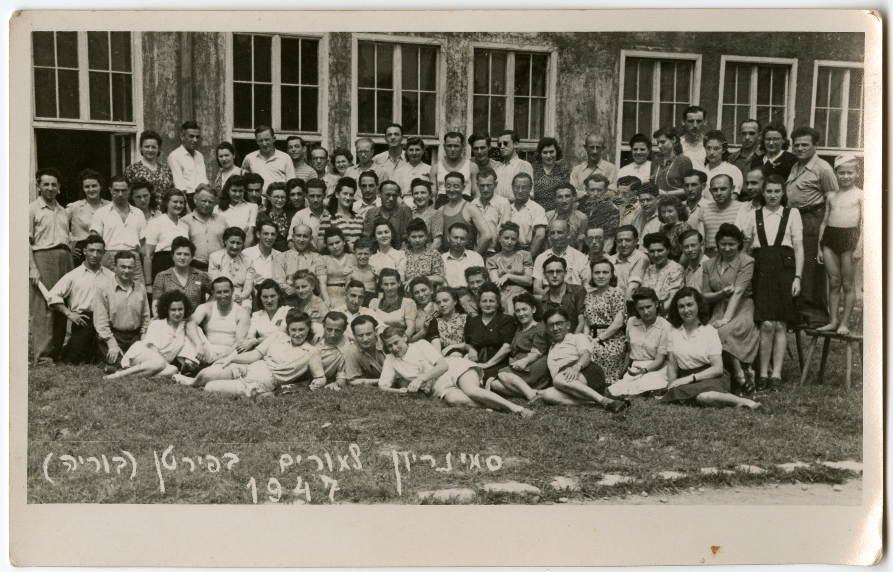 Group portrait of the students at the teacher's seminary in Puerten, Bavaria.    Laura Kimmel is pictured seated in the second row, far right.