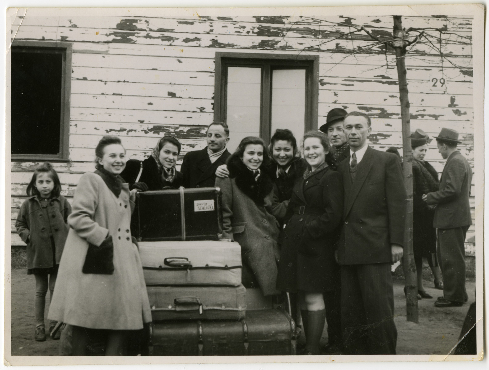 Residents of the Schlachtensee displaced persons' camp bid farewell to the Rothbaums who are leaving for America.  Pictured are Lusia, Genia and Chajka Rothbaum as well as Laura Kimmel (fourth from right) and Alfred Kimmel (second from right).