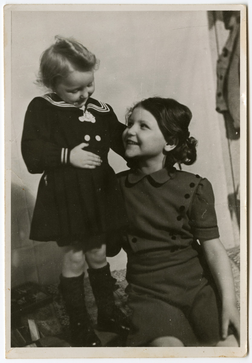 Studio portrait of two sisters in the Schlachtensee displaced persons' camp: Nonna (b. 3/27/45) and Sweata (b. 10/31/39) Zimmerman.