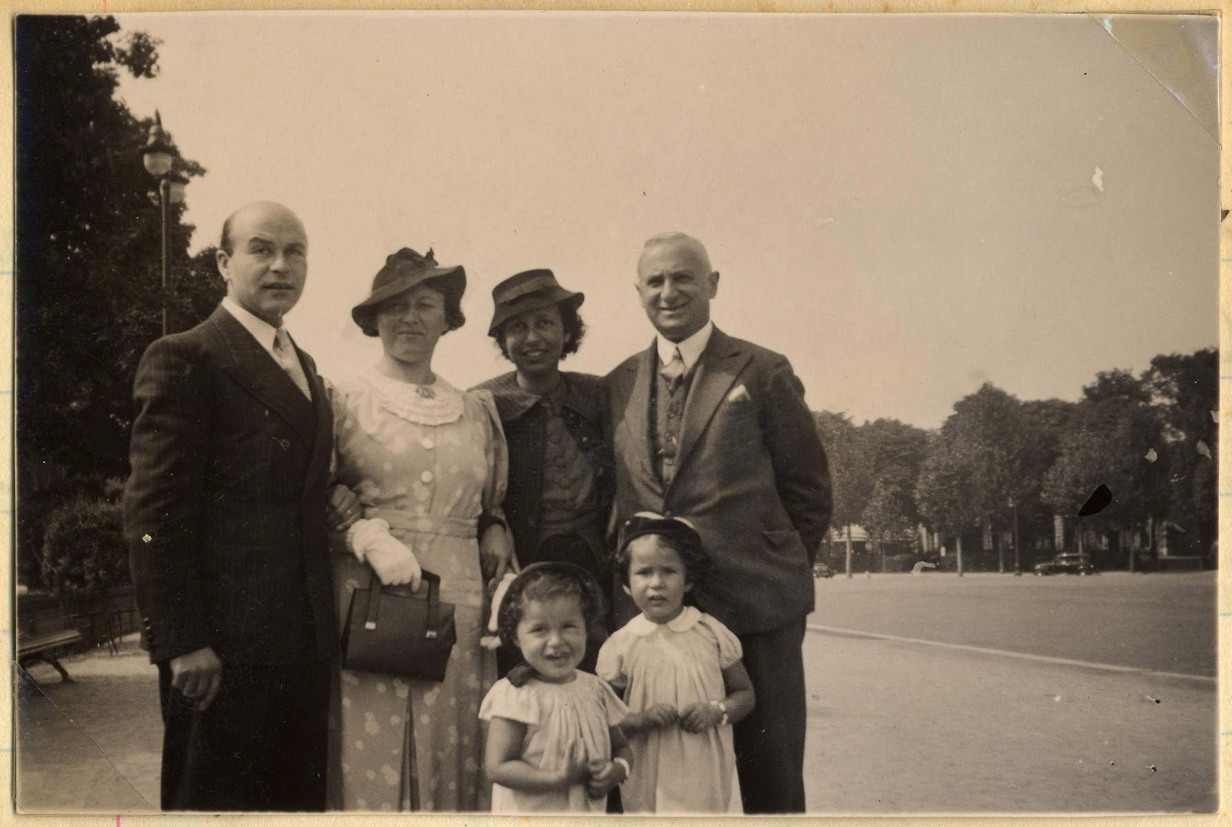 The Van Weenen family visits the Mendels family in Paris.  Standing in front (left to right) are Jacqueline and Manuela Mendels.  Standing behind them (left to right) are Frits Mendels, Thea van Weenen, Ellen Mendels, and Albert Van Weenen.  Thea van Weenen later perished in Sobibor.