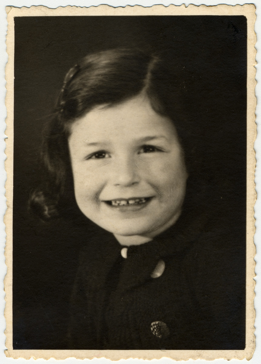 Studio portrait of six-year-old Jacqueline Mendels taken approximately one year before her family went into hiding.