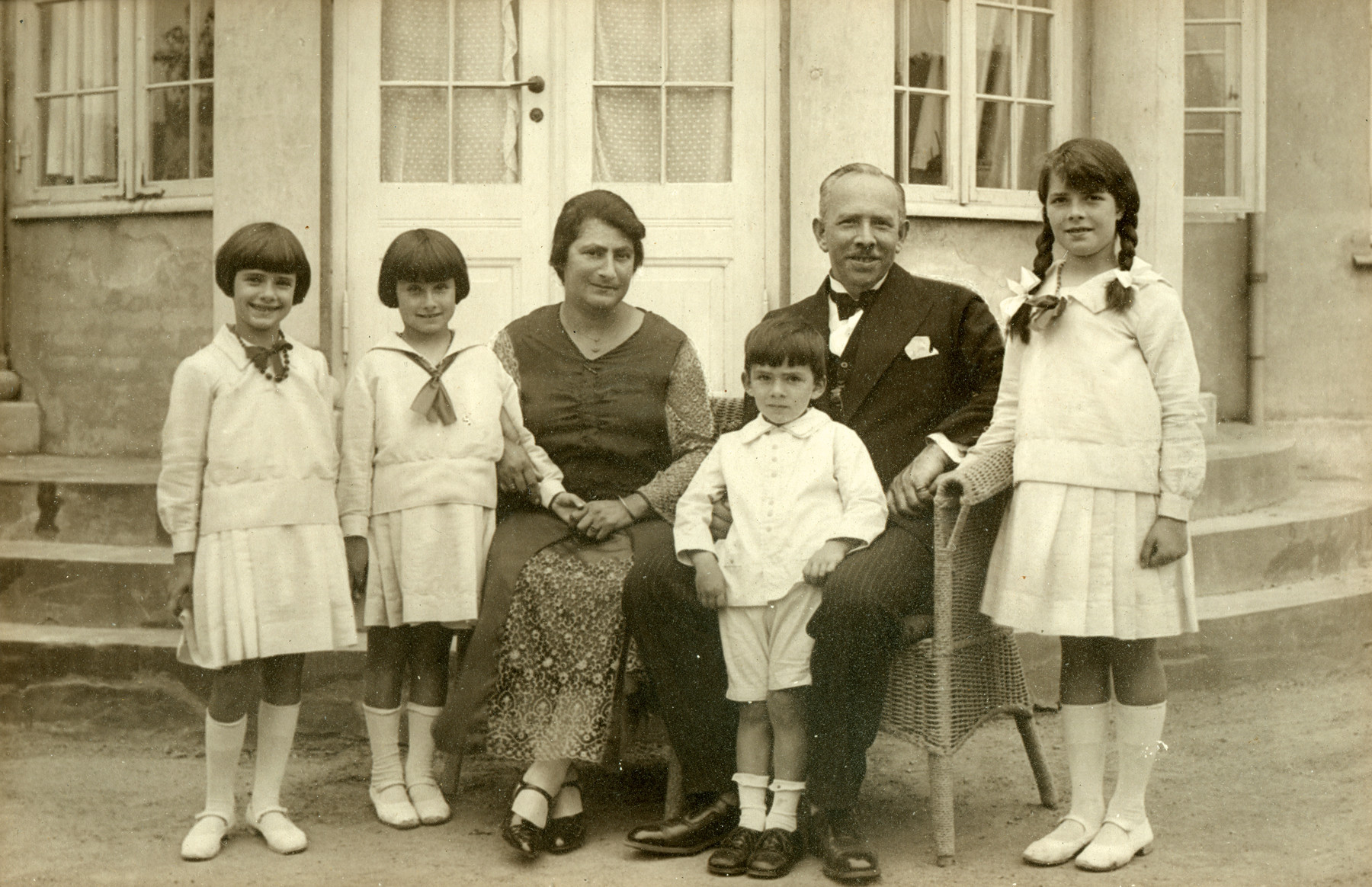 The Oestermann family celebrates Moritz Oestermann's fiftieth birthday in a mansion they rented for the occasion.  Pictured are Margot, Lillian, Gertrud, Richard, Moritz and Else Oestermann.