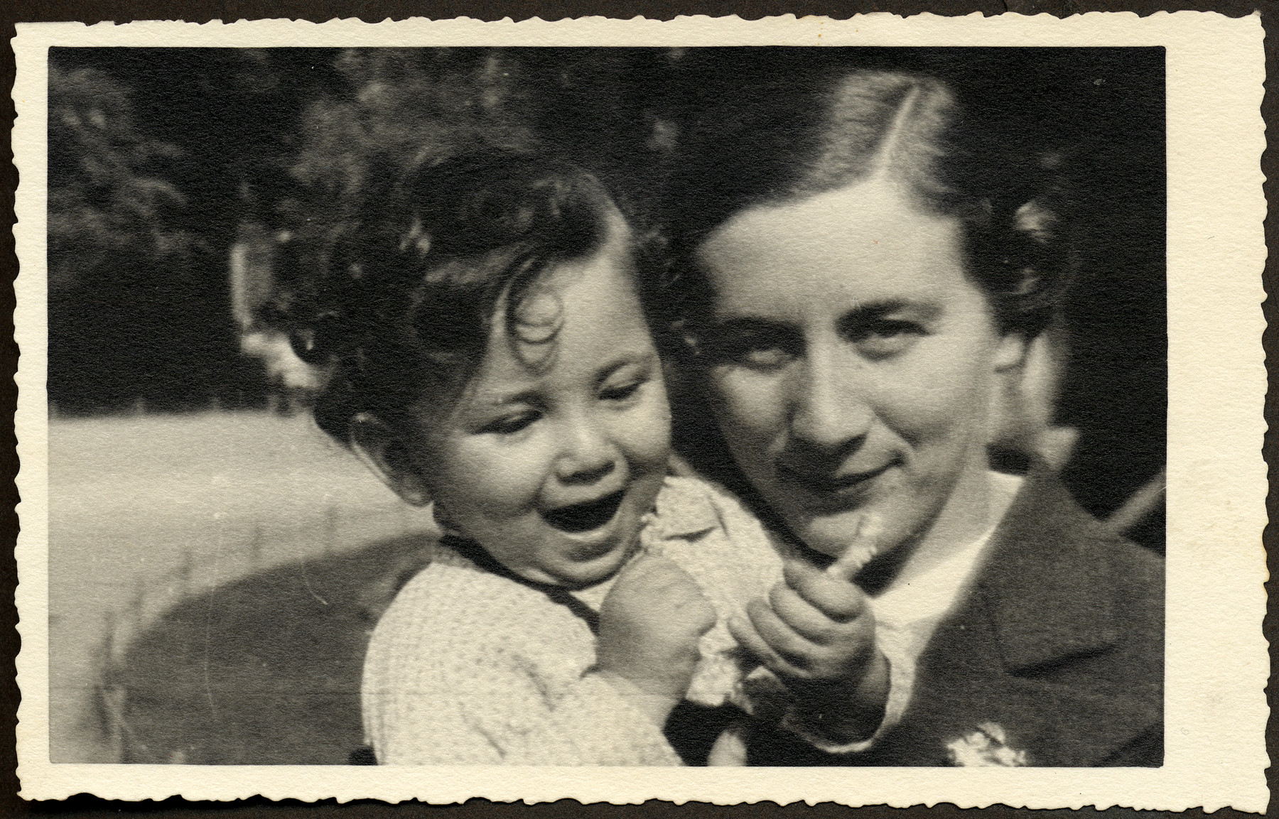 Magda Klein holds her young nephew Manny Mandel.